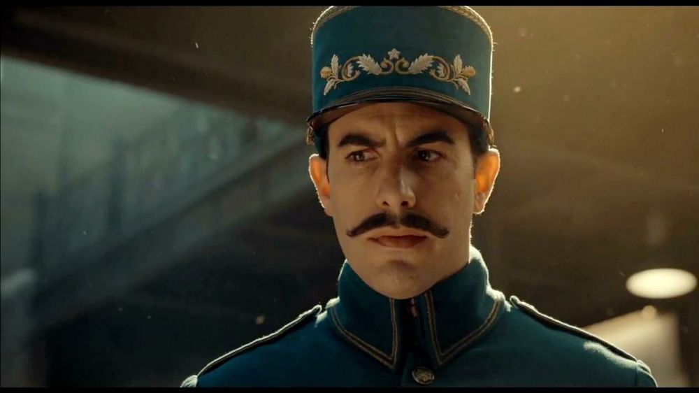 sacha baron cohen as the station inspector in hugo cultjer