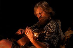 Viggo Mortensen plays the guitar
