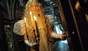 Mia Wasikowska holds some candles