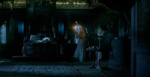Mia Wasikowska with candles in a dark room, Crimson Peak