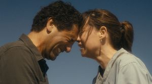Cliff Curtis and Elizabeth Rodriguez as Travis and Eliza