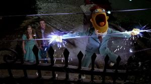 Jason Segel throws Walter onto an electric fence in The Muppets