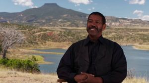 See Denzel Washington as Sam Chisholm in 'The Magnificent Se…