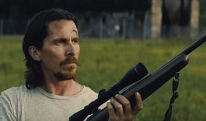 Christian Bale with huge sniper rifle