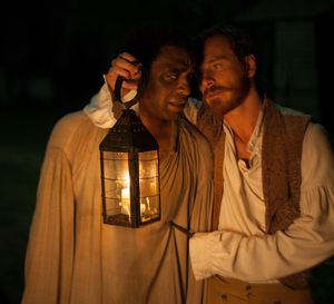 Chiwetel Ejiofor and Michael Fassbender in the dark, with a