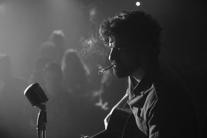 Oscar Isaac plays moody blues singer, Llewyn Davis, in the C