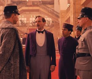 Ralph Fiennes in purple in The Grand Budapest Hotel