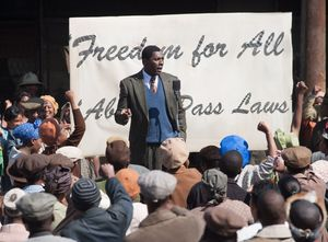 Idris Elba gives a speech as Mandela
