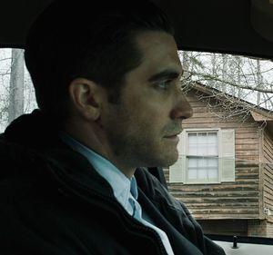 Jake Gyllenhaal in car watching