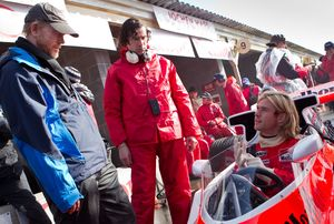 Director Ron Howard and Chris Hemsworth on the set of Rush