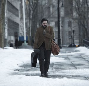 Llewyn Davis with guitar in the snow