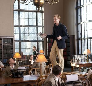 Dane DeHaan on the table in the library