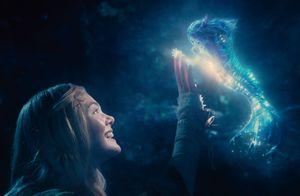Elle Fanning as Princess Aurora touching fantastical creatur
