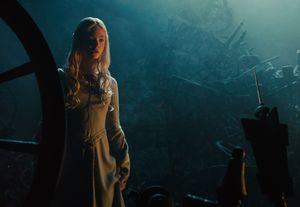 Elle Fanning in pretty dress in Maleficent