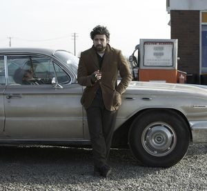 Oscar Isaac as  Llewyn Davis, smoking