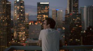 Joaquin Phoenix looks across the cityscape
