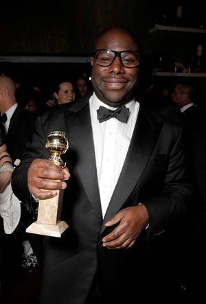 Director Steve McQueen proudly shows off his Golden Globe