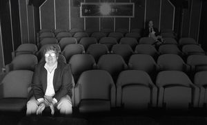 Roger Ebert in the theater watching a movie