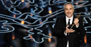 Alfonso Cuaron with his Best Director Oscar for Gravity