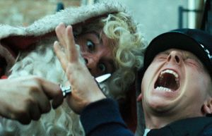 The Santa Claus who stabs Simon Pegg in Hot Fuzz is played b