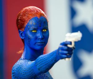 Jennifer Lawrence: blue skin, red hair, yellow eyes and a wh