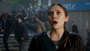 Elizabeth Olsen sees Godzilla in the rain