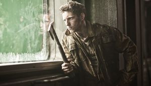 Jamie Bell with pickaxe in Snowpiercer