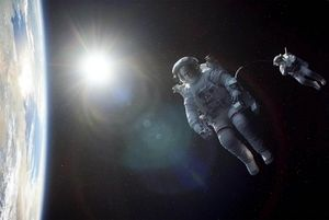 Great photo of George Clooney flying above earth in Gravity