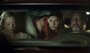 Lake Bell tries to fit in the backseat of her father's small