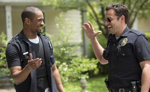 Jake Johnson and Damon Wayans Jr. high five in their uniform