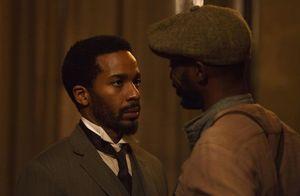 André Holland as Dr. Algernon Edwards having a conversation