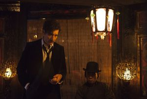 Clive Owen in a Chinese whorehouse or something