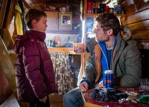 Rhys Connah as Ryan Cawood on the boat with a man who tells