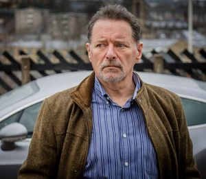 George Costigan as business man Nevison Gallagher in Happy V