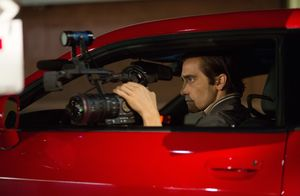 Jake Gyllenhaal filming from his red Challenger SRT8 392 in