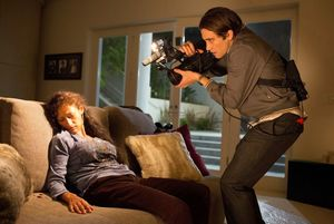 Jake Gyllenhaal films a dead woman on the couch in Nightcraw