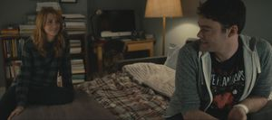 Kristen Wiig and Bill Hader on a bed