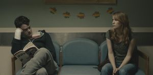 Bill Hader reading, Kristen Wiig watching, rainbow leaves
