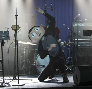 Frank performs on stage (incl. head)