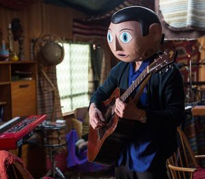 Fassbender as Frank playing the guitar