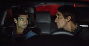 Riz Ahmed frowning at Jake Gyllenhaal in Nightcrawler