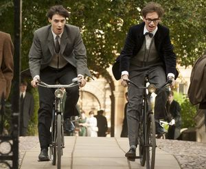 Harry Lloyd and Eddie Redmayne cycle around in The Theory of