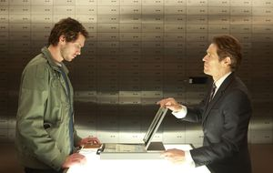 Willem Dafoe as banker providing Grigoriy Dobrygin as Issa K