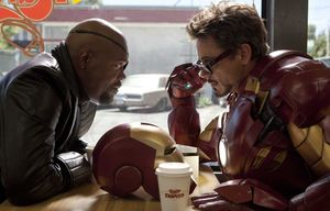 Nick Fury and Iron Man have a little chat over some coffee