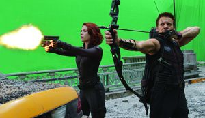 Renner and Johansson working green screen behind the scenes