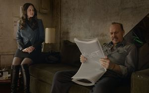 Andrea Riseborough and Michael Keaton reading the paper in B