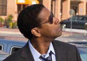 Denzel Washington looks up to a plane - Flight