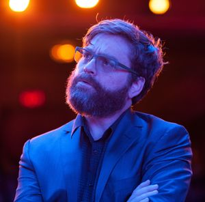 Zach Galifianakis as Jake looking bright on stage