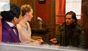 Wes Anderson on set with Saoirse Ronan and Tony Revolori