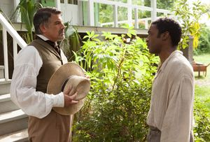 Bryan Batt and Chiwetel Ejiofor having a conversation in 12